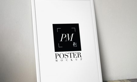 Free-Poster-Frame-on-Wooden-Background-MockUp-PSD-2018