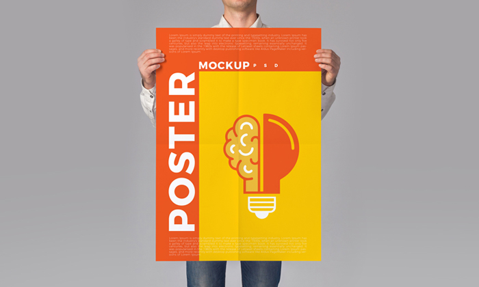 Man-Holding-Poster-Mockup-PSD-2018-300