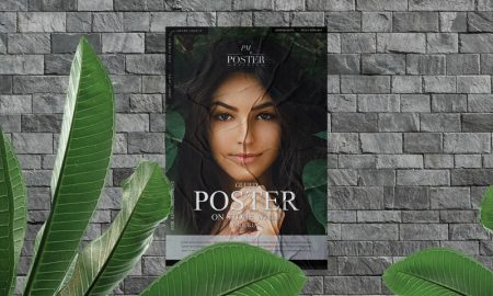 Free-Glued-Poster-on-Stone-Wall-Mockup-With-Leaves